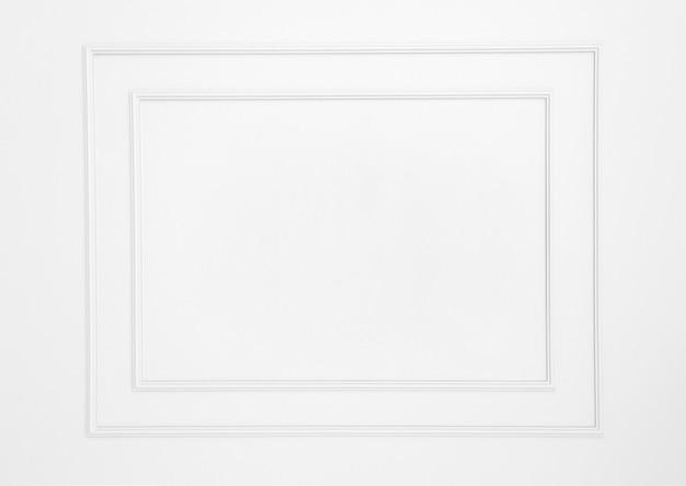 Leere rahmen auf weißer wand Premium Fotos