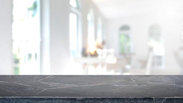 Leere schwarze marmorsteintischplatte und unscharfer kaffeestube- und restaurantinnenraumhintergrund. Premium Fotos