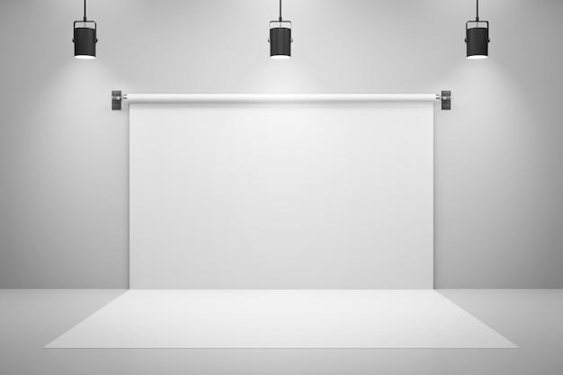 Leere weiße studiohintergründe und scheinwerfer auf unterhaltungsraumhintergrund mit zeigender szene. Premium Fotos