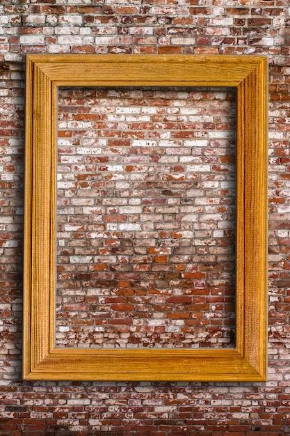 Leerer fotorahmen auf alter backsteinmauer Premium Fotos