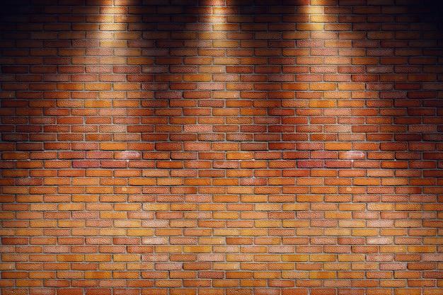 Leerer grungy raum mit wand des roten backsteins und drei scheinwerferstrahlen Premium Fotos