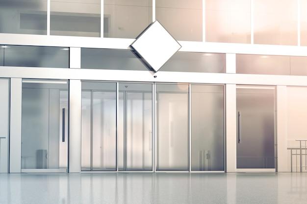 Leeres weißes rauten-beschilderungsmodell auf dem schiebetür-eingang des geschäftsglases Premium Fotos