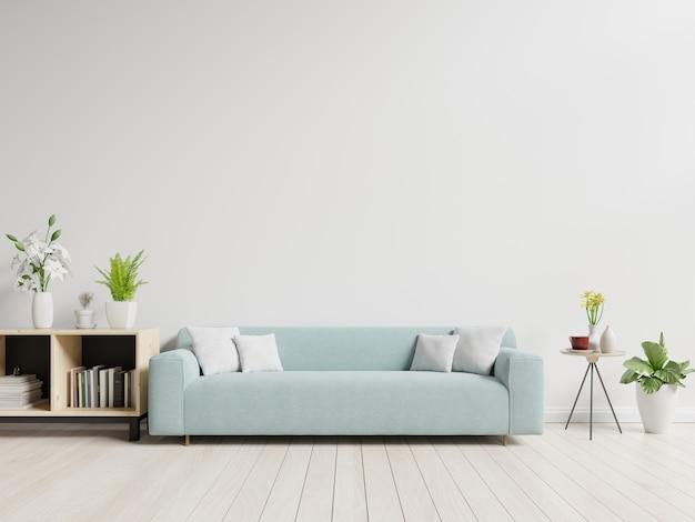 Leeres wohnzimmer mit blauem sofa, anlagen und tabelle auf leerem weißem wandhintergrund. Premium Fotos