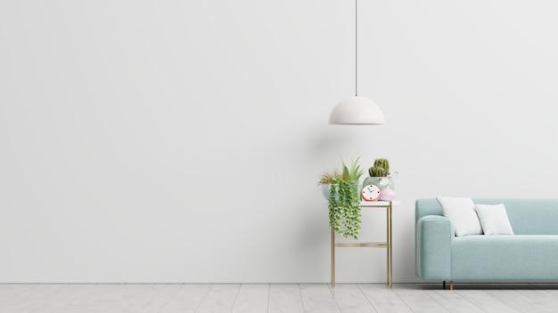 Leeres wohnzimmer mit blauem sofa, pflanzen und tabelle auf leerem weißem wandhintergrund. 3d-rendering Kostenlose Fotos