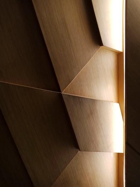 Licht, das auf ein hölzernes abstraktes design fällt Kostenlose Fotos