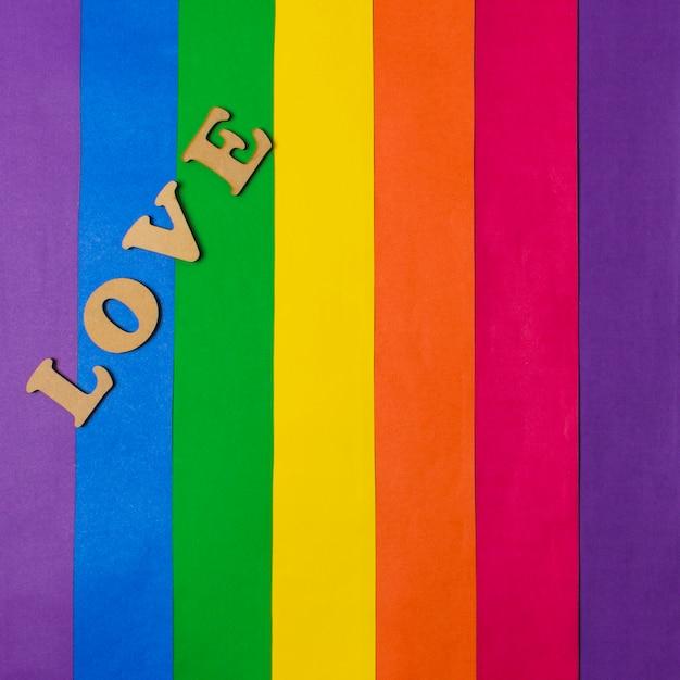 Liebeswort und lgbt-flagge Kostenlose Fotos