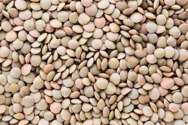 Linsen hülsenfrüchte hülsenfrüchte gemüse vegetarischen lebensmittel hintergrund. Premium Fotos