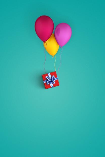 Luftballons süchtig zu einem geschenkpaket Kostenlose Fotos
