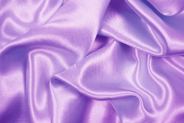 Luxusstoffbeschaffenheit des schönen purpurroten satins kann als hochzeitshintergrund, gewebe verwenden Premium Fotos