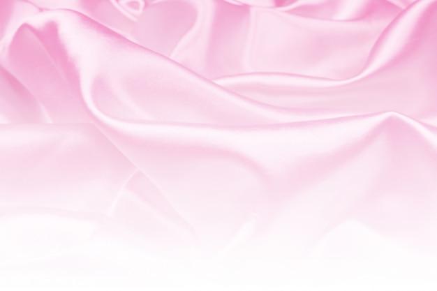 Luxusstoffbeschaffenheit des schönen rosa satins kann als hochzeitshintergrund, gewebe verwenden Premium Fotos