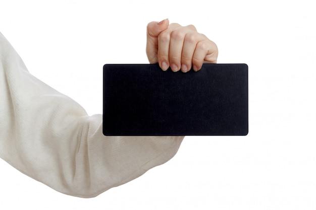 Mädchen, das eine kleine leere tafel hält Premium Fotos