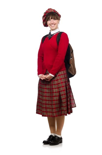 Mädchen in der schottischen schottenstoffkleidung lokalisiert auf weiß Premium Fotos