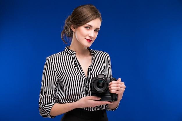 Mädchen mit kamera Premium Fotos
