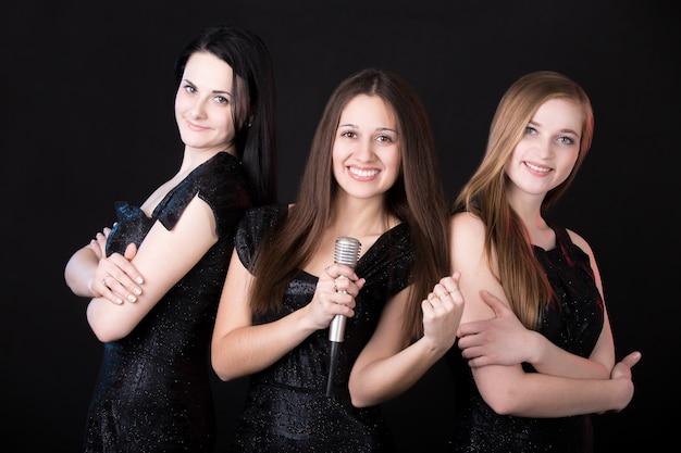 Mädchen musikband mit mikrofon Kostenlose Fotos