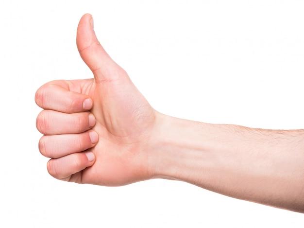 Männliche hand zeigt daumen hoch vorbei zu unterzeichnen. Premium Fotos