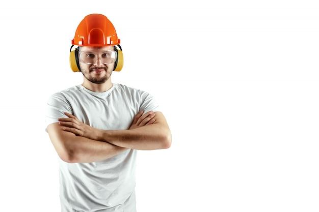 Männlicher erbauer im orange sturzhelm lokalisiert auf weißem hintergrund Premium Fotos