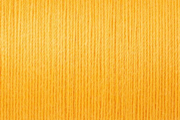 Makrobild des gelben threadbeschaffenheitshintergrundes Premium Fotos