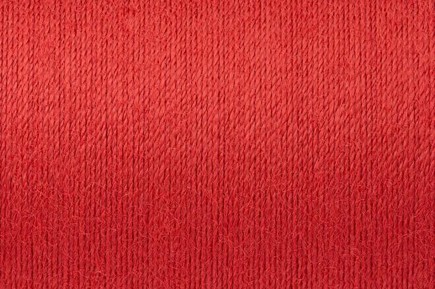Makrobild des roten threadbeschaffenheitshintergrundes Premium Fotos
