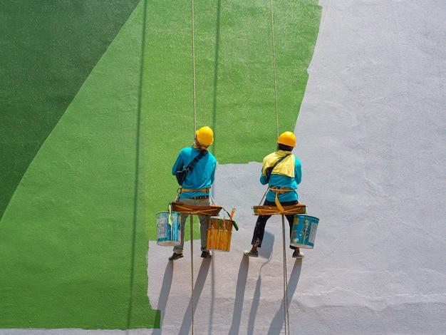 Maler, die äußeres des gebäudes malen Premium Fotos