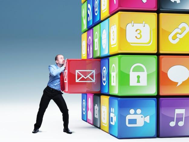Man move cube bestehend aus elementen mit symbolen in verschiedenen farben Premium Fotos