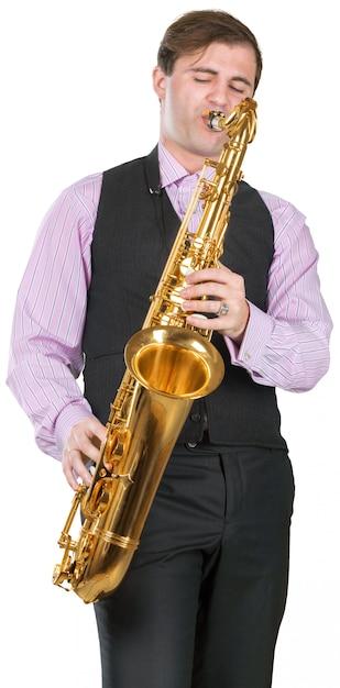Mann, der auf einem saxophon spielt Premium Fotos