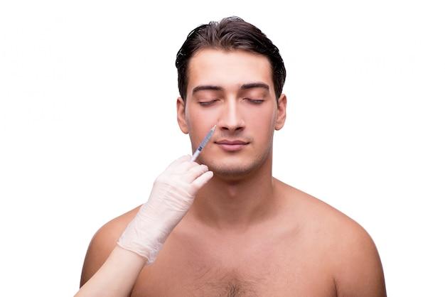 Mann, der die plastische chirurgie lokalisiert auf weiß durchmacht Premium Fotos