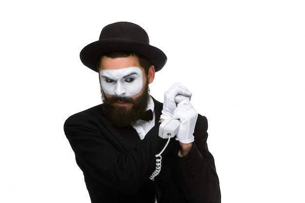 Mann im bild pantomime, der einen hörer hält. Kostenlose Fotos