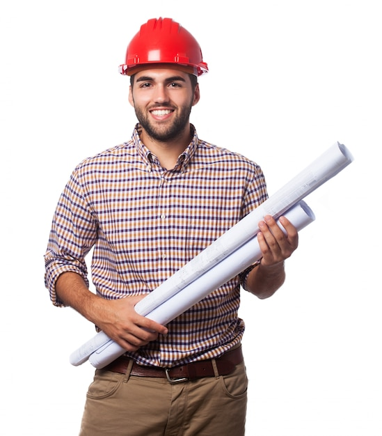 Mann mit blaupausen und helm Kostenlose Fotos