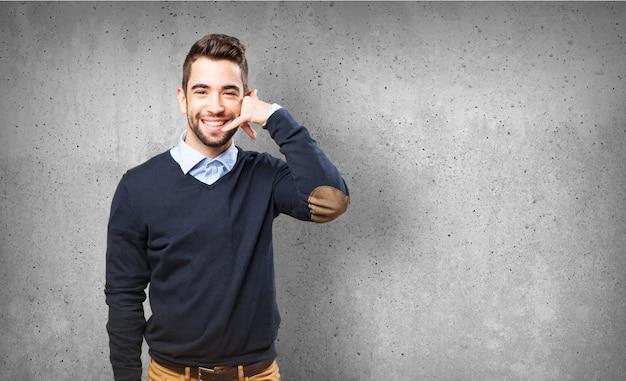 Mann mit einem telefon machen mit ihrer hand Kostenlose Fotos