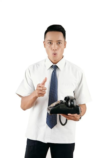 Mann mit retro telefon Kostenlose Fotos