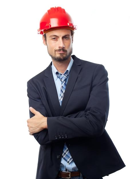 Mann mit rotem helm mit gekreuzten armen Kostenlose Fotos