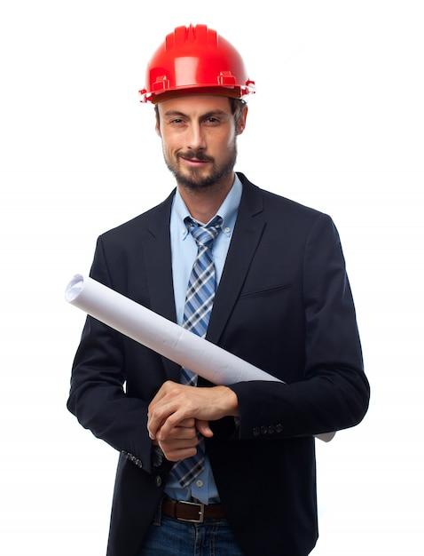 Mann mit rotem helm und anzug und pläne Kostenlose Fotos