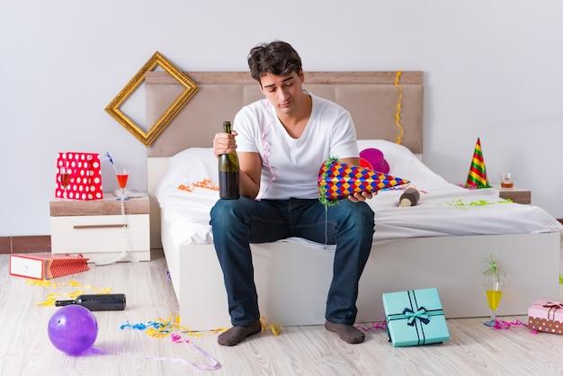 Mann nach schwerem weihnachten zu hause partying Premium Fotos