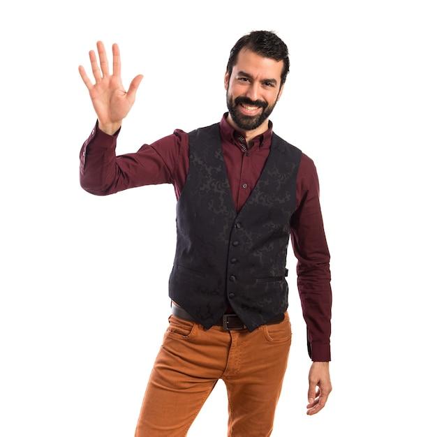 Mann trägt weste begrüssen Kostenlose Fotos