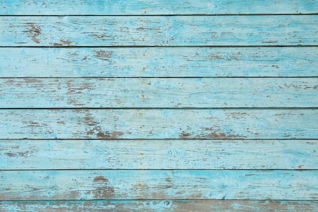 Masern sie hölzernen hintergrund mit alter gebrochener blauer farbe Premium Fotos
