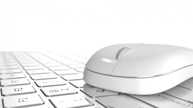 Maus auf laptop auf selektivem fokus des arbeitsschreibtischs auf weißem hintergrund. Premium Fotos