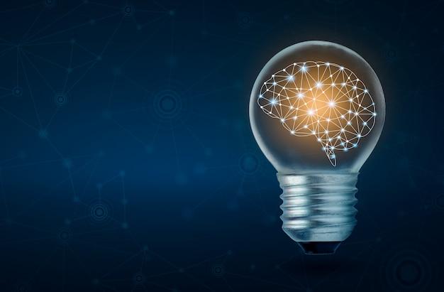 Menschliches gehirn der glühlampe des gehirns, das innerhalb der glühlampe auf dunkelblauem hintergrund glüht Premium Fotos