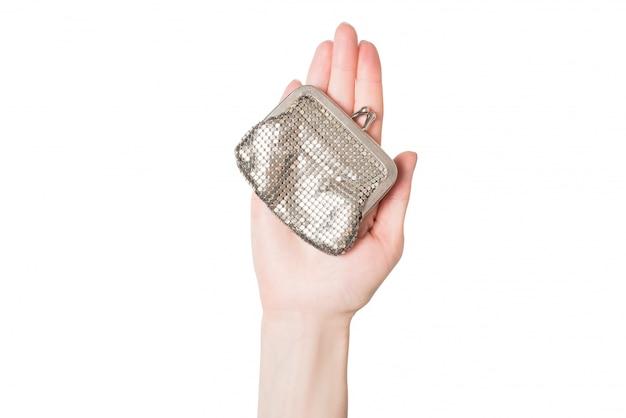 Metallgeldbeutel auf einem weiblichen palmenisolat Premium Fotos