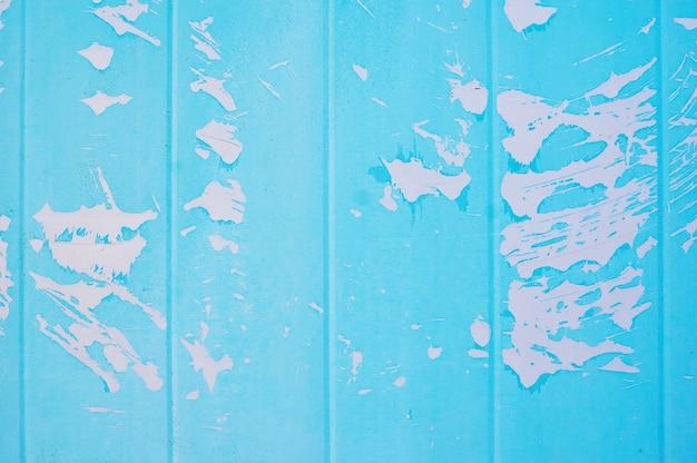 Metallhintergrund gemalte blaue farbe mit sprüngen. Premium Fotos