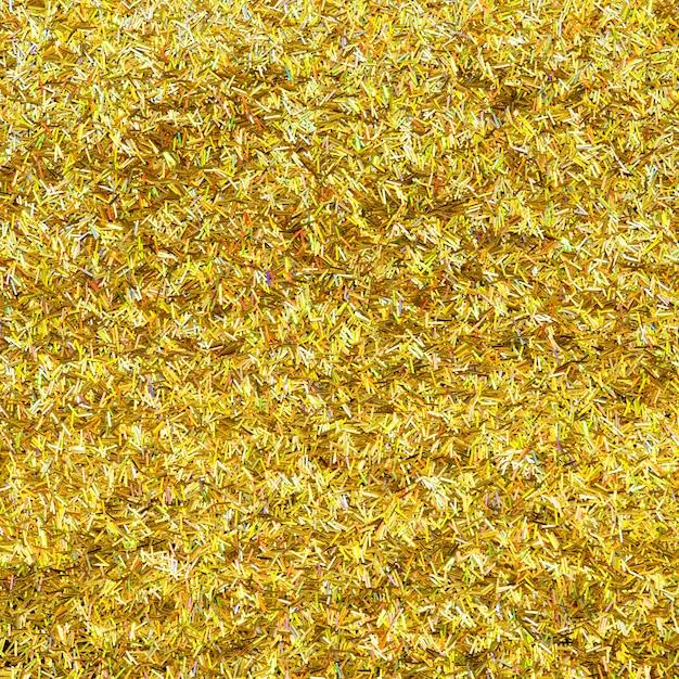 Metallischer goldfunkelnhintergrund Kostenlose Fotos
