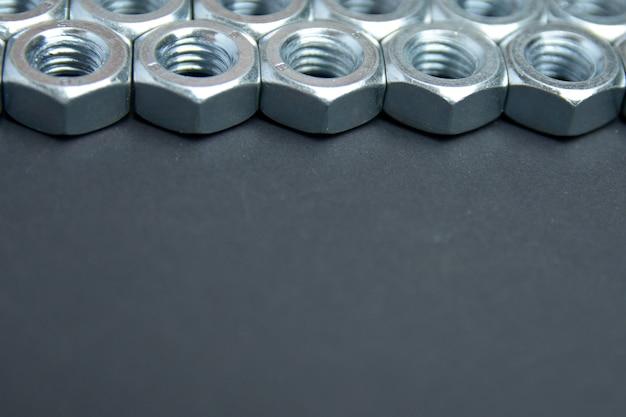 Metallschraube hintergrund. kopieren sie platz für text. konzeptansicht der metallmutter. Premium Fotos
