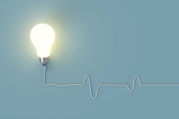Minimales konzept. hervorragende glühende glühbirne mit kabel auf blauem hintergrund für textfreiraum. Premium Fotos