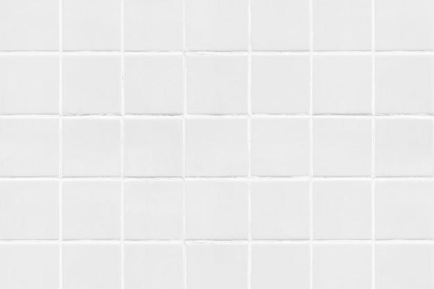 Mit ziegeln gedeckter beschaffenheitshintergrund des weißen quadrats Kostenlose Fotos