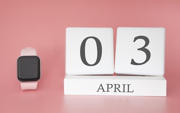 Moderne uhr mit würfelkalender und datum 03. april auf rosa hintergrund. konzept frühlingszeit urlaub. Premium Fotos