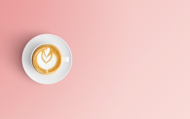 Moderner arbeitsplatz mit kaffeetasse auf rosa farbe Premium Fotos