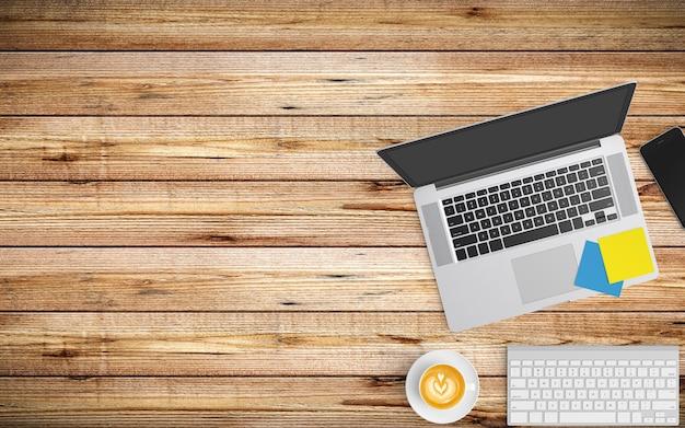 Moderner arbeitsplatz mit kaffeetasse, papier, notizbuch, tablette oder smartphone und laptop auf holz Premium Fotos