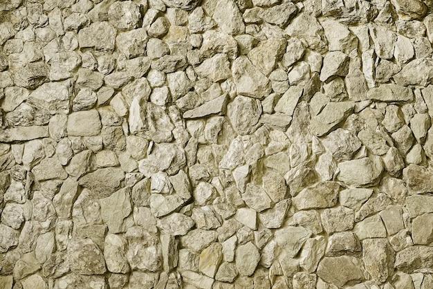 Moderner beige steinwandhintergrund Premium Fotos