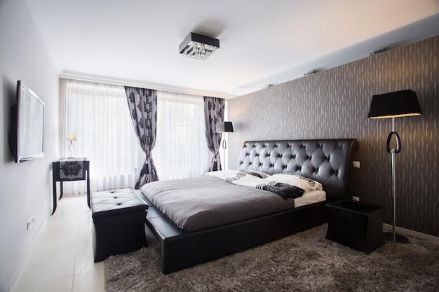 Moderner luxusschlafzimmerinnenraum Premium Fotos