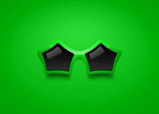 Modesonnenbrille mit sternform auf grünem hintergrund. Premium Fotos