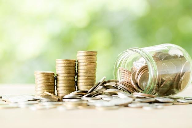Münze auf holztisch Kostenlose Fotos